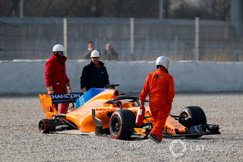 McLaren MCL33 of Fernando Alonso in the gravel trap after his rear wheel comes off