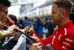 Sebastian Vettel, Ferrari, signs autograph for fans