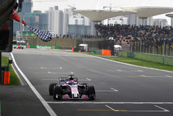 Sergio Perez, Force India VJM11 takes the chequered flag at the end of Qualifying