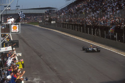 Nigel Mansell, Williams FW14B, takes the chequered flag