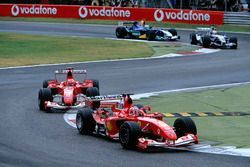 Rubens Barrichello, Ferrari F2004 leads team mate Michael Schumacher, Ferrari F2004