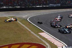 Rubens Barrichello, Honda RA107, leads Giancarlo Fisichella, Renault R27, Sebastian Vettel, Toro Ros