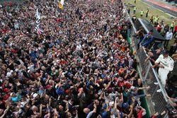 Race winner Lewis Hamilton, Mercedes AMG F1 goes crowd surfing