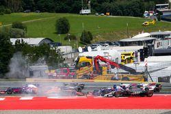 An accident involving Daniil Kvyat, Scuderia Scuderia Toro Rosso STR12, Fernando Alonso, McLaren MCL