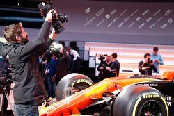 A cameraman films the McLaren MCL32