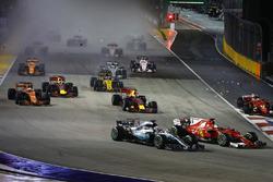 Sebastian Vettel, Ferrari SF70H, Max Verstappen, Red Bull Racing RB13, Kimi Raikkonen, Ferrari SF70H, collide at the start as Lewis Hamilton, Mercedes AMG F1 W08, finds his way through