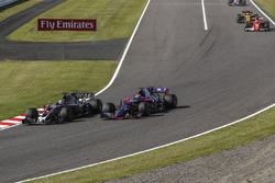 Romain Grosjean, Haas F1 Team VF-17 and Pierre Gasly, Scuderia Toro Rosso STR12 battle