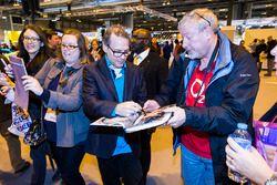 Jacques Villeneuve signs autographs for fans