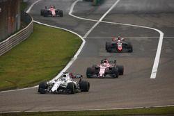 Felipe Massa, Williams FW40; Sergio Perez, Force India VJM10; Kevin Magnussen, Haas F1 Team VF-17; E