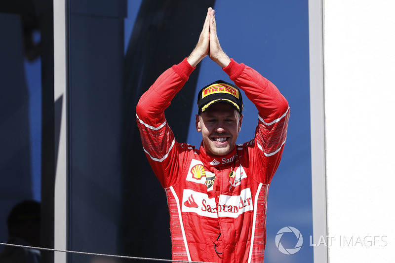 Podium: race winner Sebastian Vettel celebrates his victory on the podium