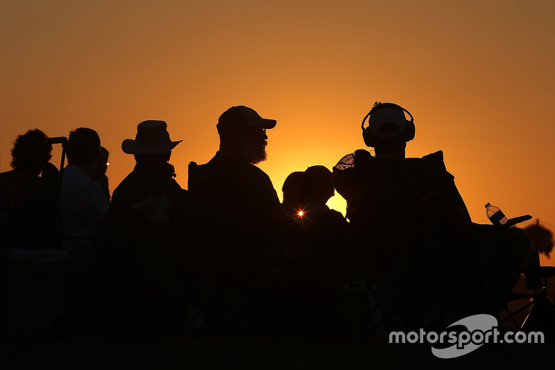 Fans at sunset