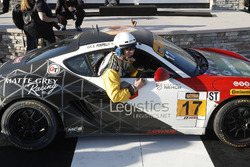 IMSA pit lane official gets into the winning car