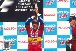 Podium: second place Rubens Barrichello, Jordan, third place Eddie Irvine, Jordan