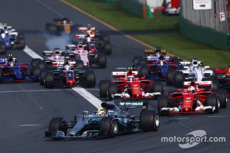 Lewis Hamilton, Mercedes AMG F1 W08, leads Sebastian Vettel, Ferrari SF70H, Valtteri Bottas, Mercedes AMG F1 W08, Kimi Raikkonen, Ferrari SF70H, and the rest of the field at the start