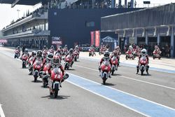 Riders in the pitlane