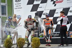 Podium: race winner Cal Crutchlow, Team LCR Honda, second place Valentino Rossi, Yamaha Factory Racing, third place Marc Marquez, Repsol Honda Team celebrate with champagne