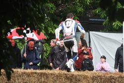 Troy Corser jumps the bales to greet fans
