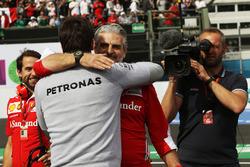 Maurizio Arrivabene, Ferrari Team Principal celebrates at the podium with Toto Wolff, Mercedes AMG F