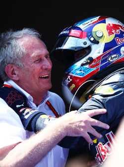 (L to R): Race winner Max Verstappen, Red Bull Racing celebrates with Dr Helmut Marko, Red Bull Moto