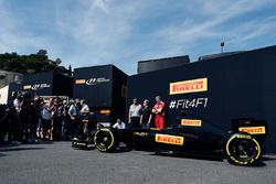 Pirelli reveal a mock up of what a 2017 F1 car and tyres may look like: Mario Isola, Pirelli Racing Manager with Gene Haas, Haas Automotion President and Maurizio Arrivabene, Ferrari Team Principal