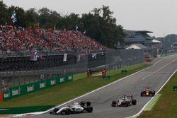 Valtteri Bottas, Williams FW38 Mercedes, leads Romain Grosjean, Haas VF-16 Ferrari and Daniel Ricciardo, Red Bull Racing RB12 TAG Heuer