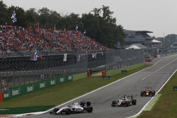 Valtteri Bottas, Williams FW38 Mercedes, leads Romain Grosjean, Haas VF-16 Ferrari and Daniel Ricciardo, Red Bull Racing RB12 TAG Heuer