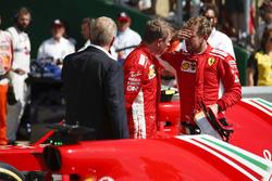 Kimi Raikkonen en Sebastian Vettel, Ferrari, in Parc Ferme