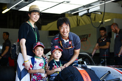 Haas F1 Team race engineer Ayao Komatsu with guests in the Haas garage