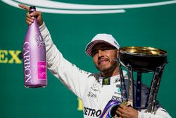 Race winner Lewis Hamilton, Mercedes AMG F1, with his pink Champagne bolt and trophy on the podium