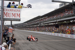 Michael Schumacher, Ferrari F2005 crosses the finish