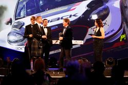 Malcolm Wilson receives the Rally Car of the Year Award from Marcus Gronholm