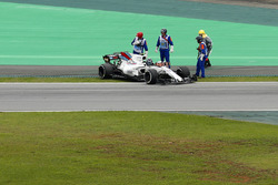 Lance Stroll, Williams FW40, climbs from his car after stopping on track