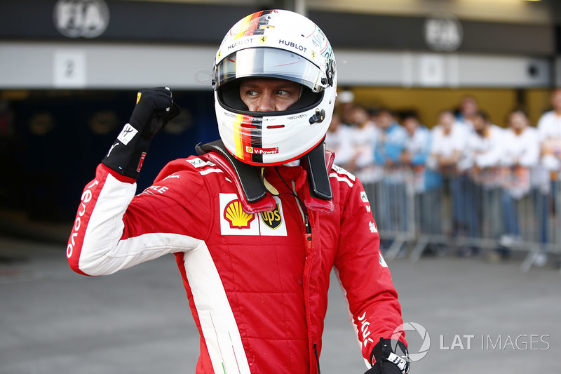 Sebastian Vettel, Ferrari, celebrates after taking Pole Position