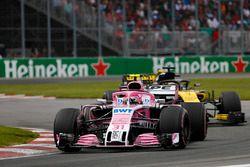 Esteban Ocon, Force India VJM11, leads Nico Hulkenberg, Renault Sport F1 Team R.S. 18