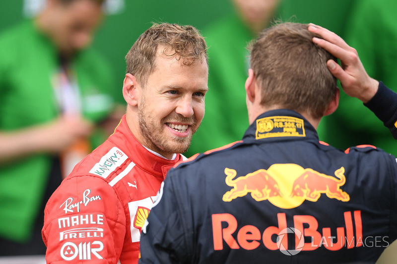 Sebastian Vettel, Ferrari and Max Verstappen, Red Bull Racing in parc ferme