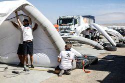Peugeot Sport team members set up tents