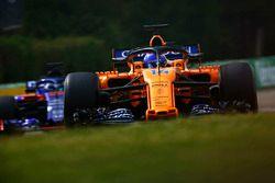 Fernando Alonso, McLaren MCL33, leads Brendon Hartley, Toro Rosso STR13