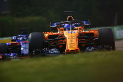 Fernando Alonso, McLaren MCL33, leads Brendon Hartley, Toro Rosso STR13