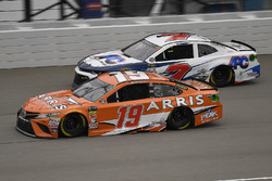 Daniel Suarez, Joe Gibbs Racing, Toyota Camry ARRIS and D.J. Kennington, Premium Motorsports, Chevro