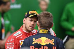 Sebastian Vettel, Ferrari en Max Verstappen, Red Bull Racing in parc ferme