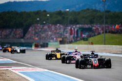 Romain Grosjean, Haas F1 Team VF-18, leads Sergio Perez, Force India VJM11, and Nico Hulkenberg, Renault Sport F1 Team R.S. 18