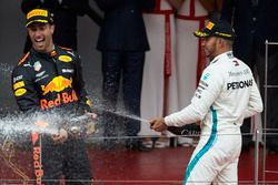 Lewis Hamilton, Mercedes AMG F1, and Race winner Daniel Ricciardo, Red Bull Racing, sprays with Champagne