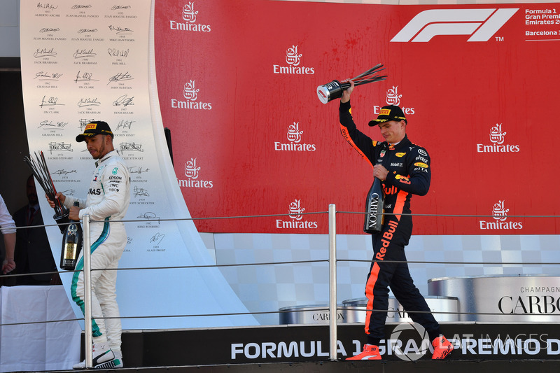 Lewis Hamilton, Mercedes-AMG F1 and Max Verstappen, Red Bull Racing celebrate on the podium