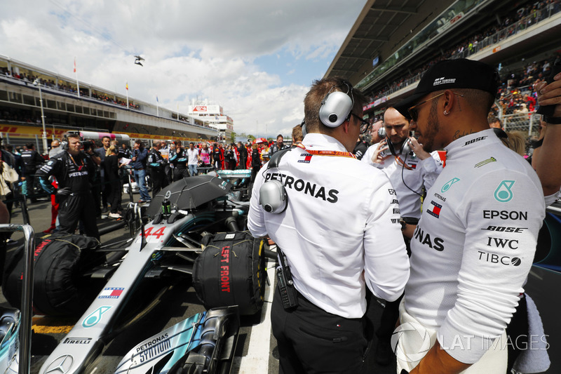 Lewis Hamilton, Mercedes AMG F1, talks to his engineer on the grid