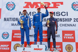 Race 2 podium: winner Karthik Tharani. second place Sandeep Kumar, third place Anindith Reddy