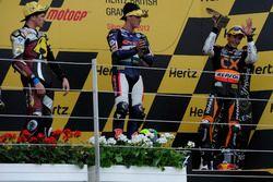 Podio: segundo lugar Scott Redding, ganador de la carrera Pol Espargaró, tercer lugar Marc Márquez