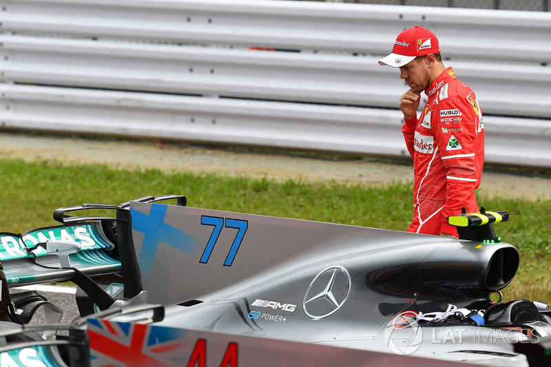 Sebastian Vettel, Ferrari looks at Mercedes-Benz F1 W08  in parc ferme