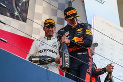 Lewis Hamilton, Mercedes AMG F1 and Max Verstappen, Red Bull Racing celebrate on the podium with the