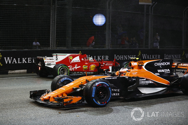 Stoffel Vandoorne, McLaren MCL32 passes Sebastian Vettel, Ferrari SF70H after he hits the wall