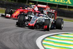 Romain Grosjean, Haas F1 Team VF-16 and Kimi Raikkonen, Ferrari SF16-H with Halo cockpit covers